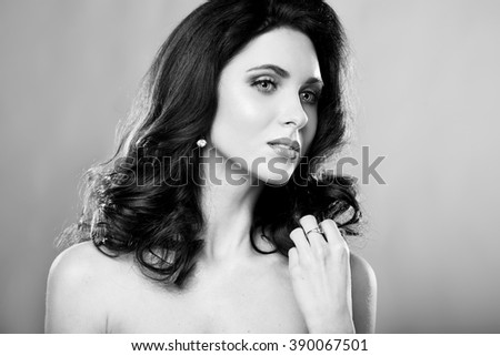 Beauty portrait of young sensual woman with glamour makeup.