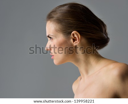 Beauty portrait of young woman isolated on gray background