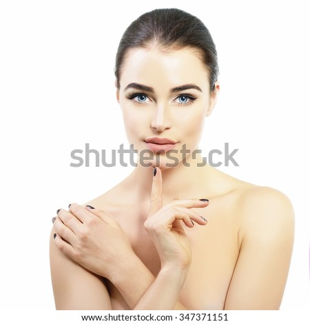 Beauty portrait of young woman touching her beautiful healthy face with her hands, studio shot of attractive girl over white background - stock photo