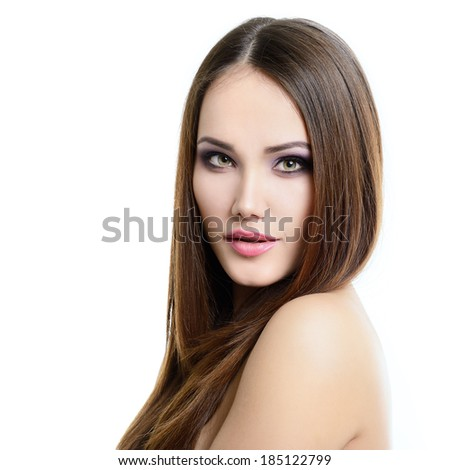 Beauty portrait of young woman with beautiful healthy face and long brown hair looking at camera, studio shot of attractive fresh girl over white background.