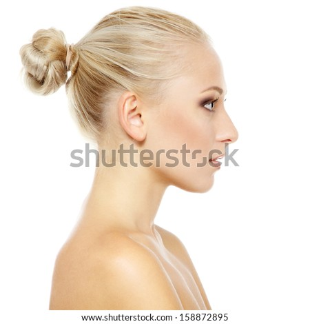 Beauty portrait of young woman with beautiful healthy face in profile, studio shot of attractive girl on white background