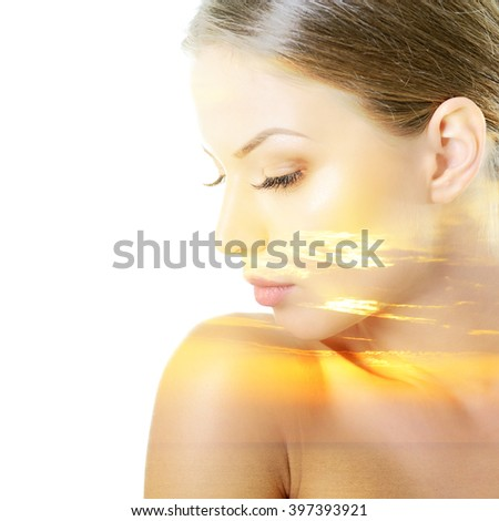 Beauty portrait of young woman with beautiful healthy face in profile, studio shot of attractive girl over on white background - stock photo