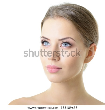 Beauty portrait of young woman with beautiful healthy face with nice day makeup looking up, studio shot of attractive girl over on white background - stock photo