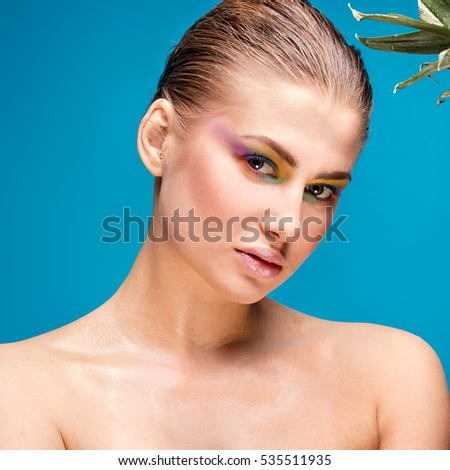 Beauty portrait of young woman with colorful glamour makeup .