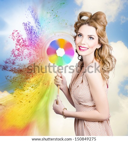 Beauty portrait. Pretty girl holding toy spraying colored paint in a hair and makeup coloring concept  - stock photo