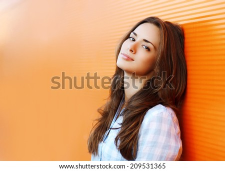 Beauty portrait pretty woman in the city summer near colorful wall - stock photo