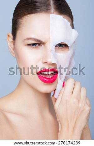 Beauty portrait with a mask sheet - stock photo