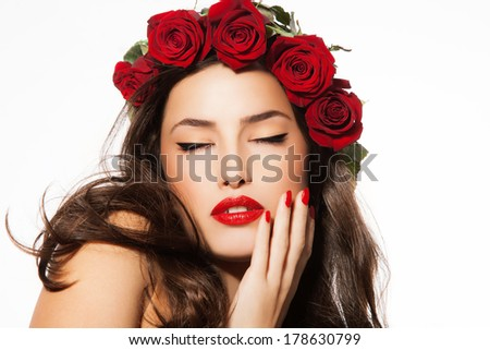 beauty portrait with red roses, lipstick and nail polish, studio white - stock photo