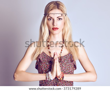 Beauty portrait woman doing yoga. Boho hippie girl meditates, enjoying calm, relax and harmony, ethnic accessories. Positive blonde, long hair in stylish floral sundress. Unusual creative, people - stock photo