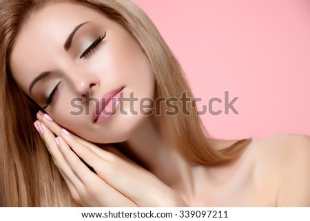 Beauty portrait woman with eyes closed, sleeping. Sensual attractive pretty nude blonde model girl dreaming on pink, shiny straight hair. People face closeup, natural makeup, perfect skin, copyspace - stock photo