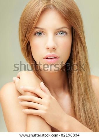 beauty portrait young blonde woman hands shoulder - stock photo