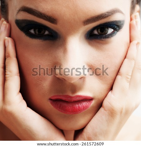 Beauty portrait young woman  holding her face between hands. Developed from RAW - stock photo