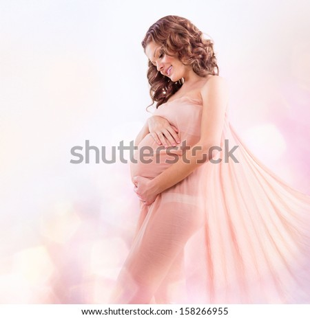 Beauty Pregnant Woman in Blowing Pink Chiffon Shawl. Pregnant Belly. Beautiful Pregnant Woman Expecting Baby. Maternity concept. Baby Shower - stock photo