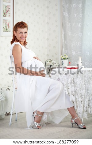 beauty pregnant woman in white interior