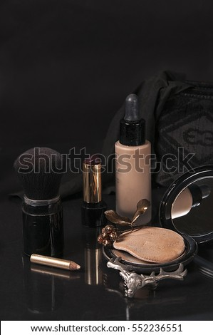 beauty products still life on black