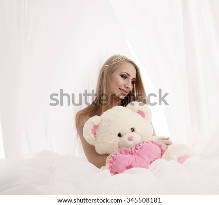 Beauty queen posing with plush teddy bear