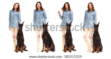 Beauty red girl in jeans shirt with big black doberman dog, isolated on white - stock photo