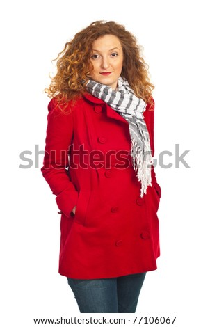 Beauty redhead woman in red jacket isolated on white background