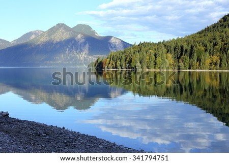 beauty reflecting lake in bavarian mountains at morning