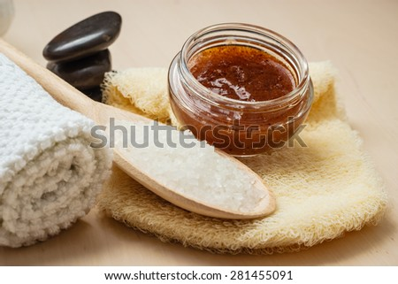 Beauty relaxation and body care. Closeup spa products some bath accessories on wooden table. - stock photo