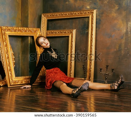 beauty rich brunette woman in luxury interior near empty frames, vintage elegance hispanic, home alone - stock photo