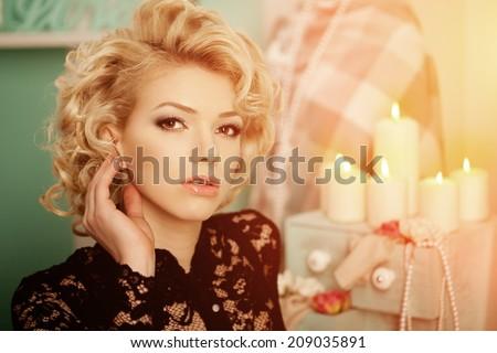 Beauty rich luxury woman like Marilyn Monroe. Beautiful fashionable girl in a retro interior - stock photo