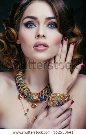 beauty rich woman with luxury jewellery looks like mature close up, bright makeup - stock photo