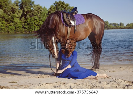 Beauty rider. Charming girl in a long blue dress. Fashionable toning. creative colors