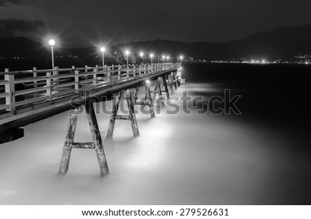 Beauty romantic pier on Patong Beach on Phuket, Thailand - stock photo