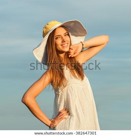 Beauty Romantic Woman Outdoors. Beautiful Teenage Model girl Dressed in Casual Short Dress on Field in Sun Light. Portrait - stock photo