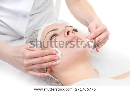 beauty salon, facial mask wiping, removing with napkins - stock photo