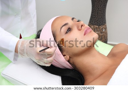 Beauty salon, facial peeling mask with retinol and fruit acids.
