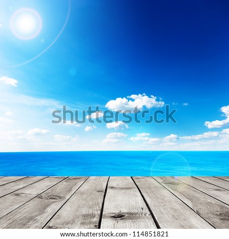 Beauty seascape under blue clouds sky. View from wood pier - stock photo