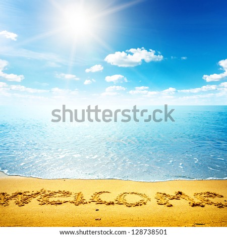 Beauty seascape. Word welcome on the sand beach. Nature background - stock photo