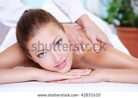 Beauty serene woman getting relaxation in the spa salon - stock photo