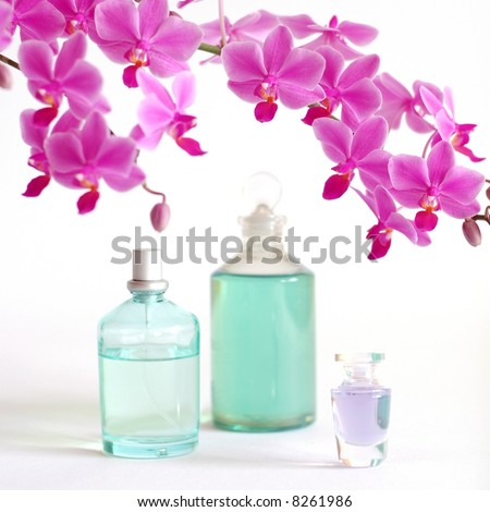 Beauty set with massage oil, perfume and orchid - stock photo