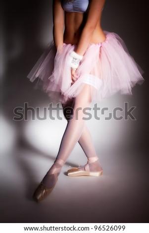 Beauty sexy ballerina in pointes on white studio background - stock photo