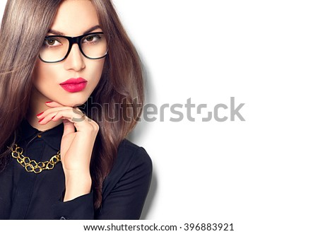 Beauty sexy fashion model woman portrait wearing glasses, isolated on white background. Beautiful young brunette girl with trendy accessories posing in studio - stock photo