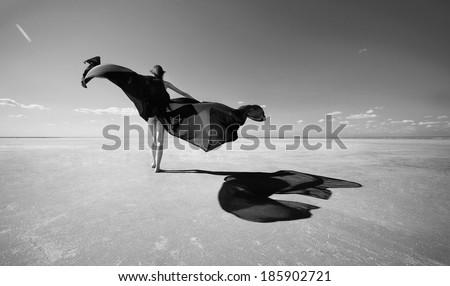 Beauty sexy skinny girl on the salt lake desert - stock photo