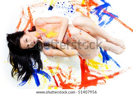 Beauty shoot of beautiful woman lay on the floor and painted with different colors