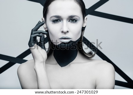 Beauty shot of a woman with geometrical makeup and backgound