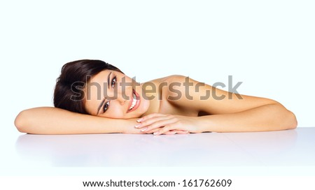 Beauty shot of a young beautiful model. Spa skincare. - stock photo