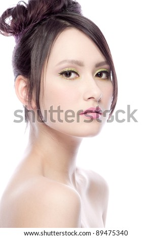 Beauty shot of a young woman with black hair - stock photo