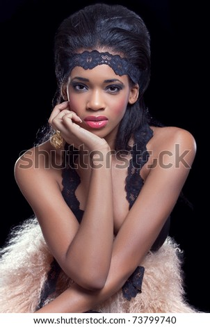 Beauty shot of a young young beautiful model, wearing fashionable clothes, isolated on black - stock photo