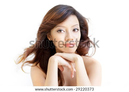 Beauty shot of an attentive chinese beautiful gal with an eager and enthusiastic expression - stock photo