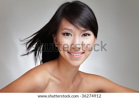 Beauty shot of an attractive Japanese beautiful gal with an eager and enthusiastic expression - stock photo