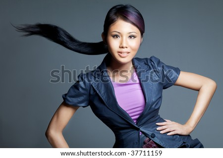 Beauty shot of Asian Peranankan fashion female model of mixed Chinese and Malay parentage - stock photo