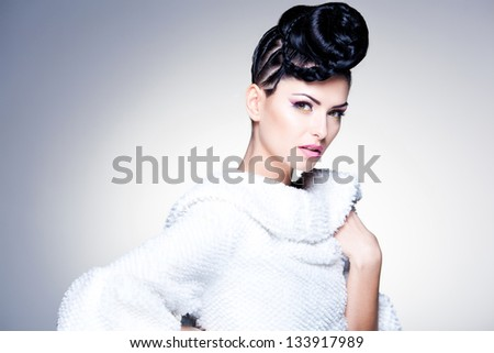 beauty shot of beautiful woman wearing professional make-up and hairstyle - stock photo