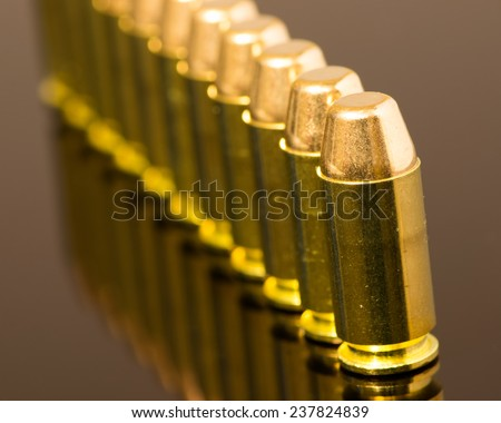 Beauty shot of .40 mm ammunition in a row.