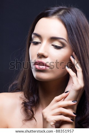 Beauty shot of young brunette girl with natural makeup - stock photo